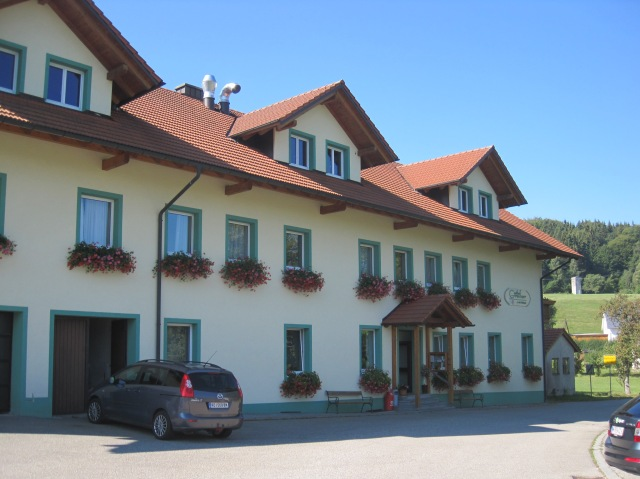 Gasthof Greiner, near Julbach, Austria. The yellow sign on the right is in Germany.