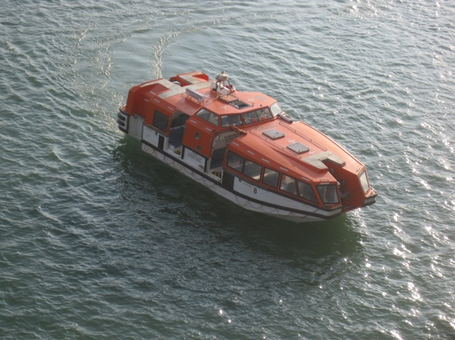 One of the ship's lifeboats as a tender